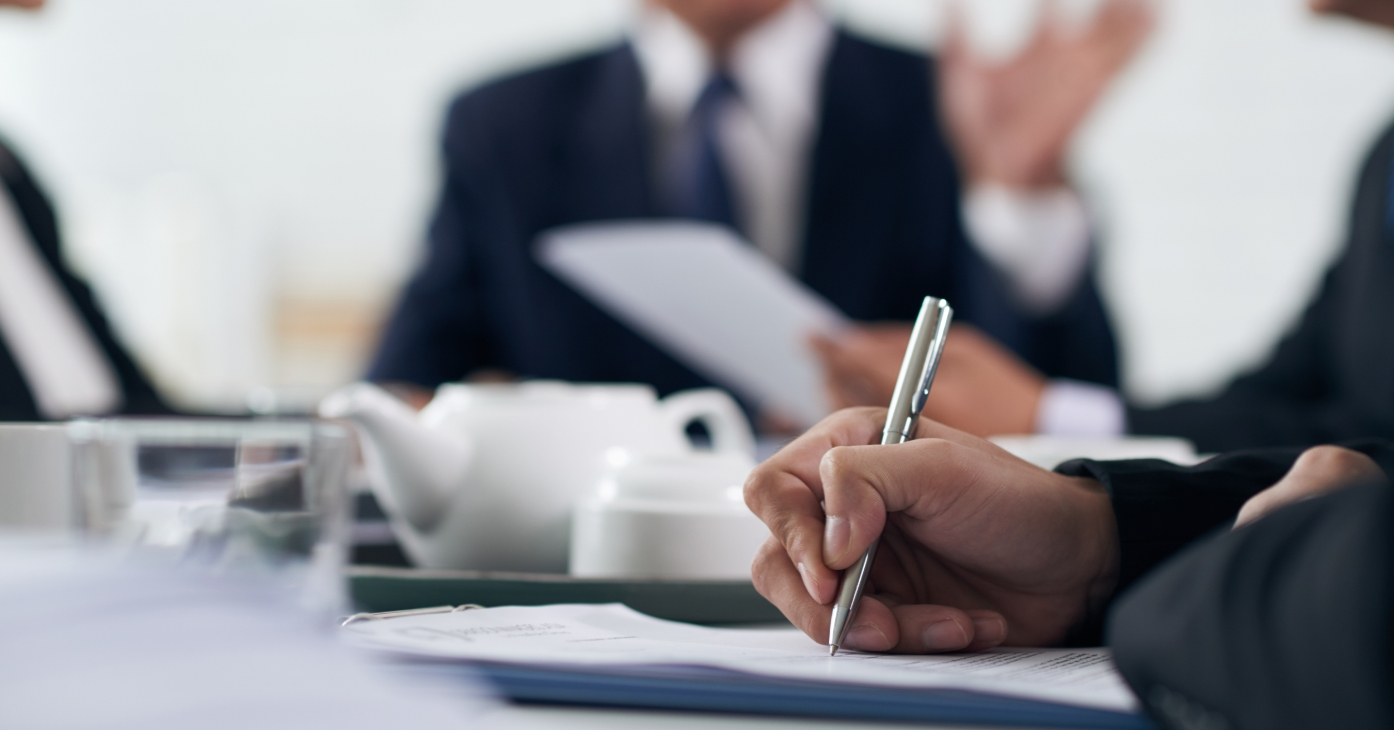businessman-analyzing-statistics-report